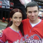 Annie Wersching poses with fan at celebrity softball game