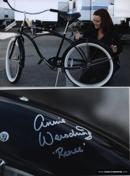 Annie Wersching signing bicycle
