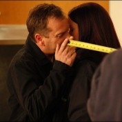Kiefer Sutherland and Annie Wersching prepare to kiss on 24