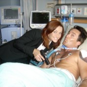 Annie Wersching and Dameon Clarke BTS 24 Hospital set smiling
