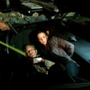 Annie Wersching and Jon Sklaroff in trunk of a car