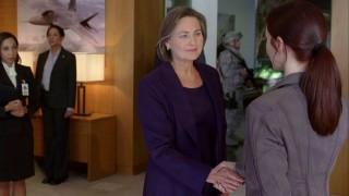 Renee Walker shakes hands with President Allison Taylor